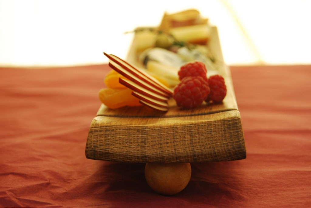 Food plated on a wooden board. Good to look at, awkward to eat off