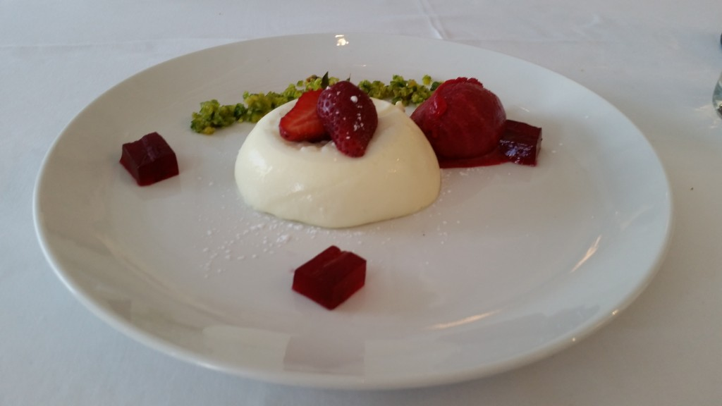 A sublime vanilla panna cotta with rose and strawberry sorbet, pistachio and rose jelly.