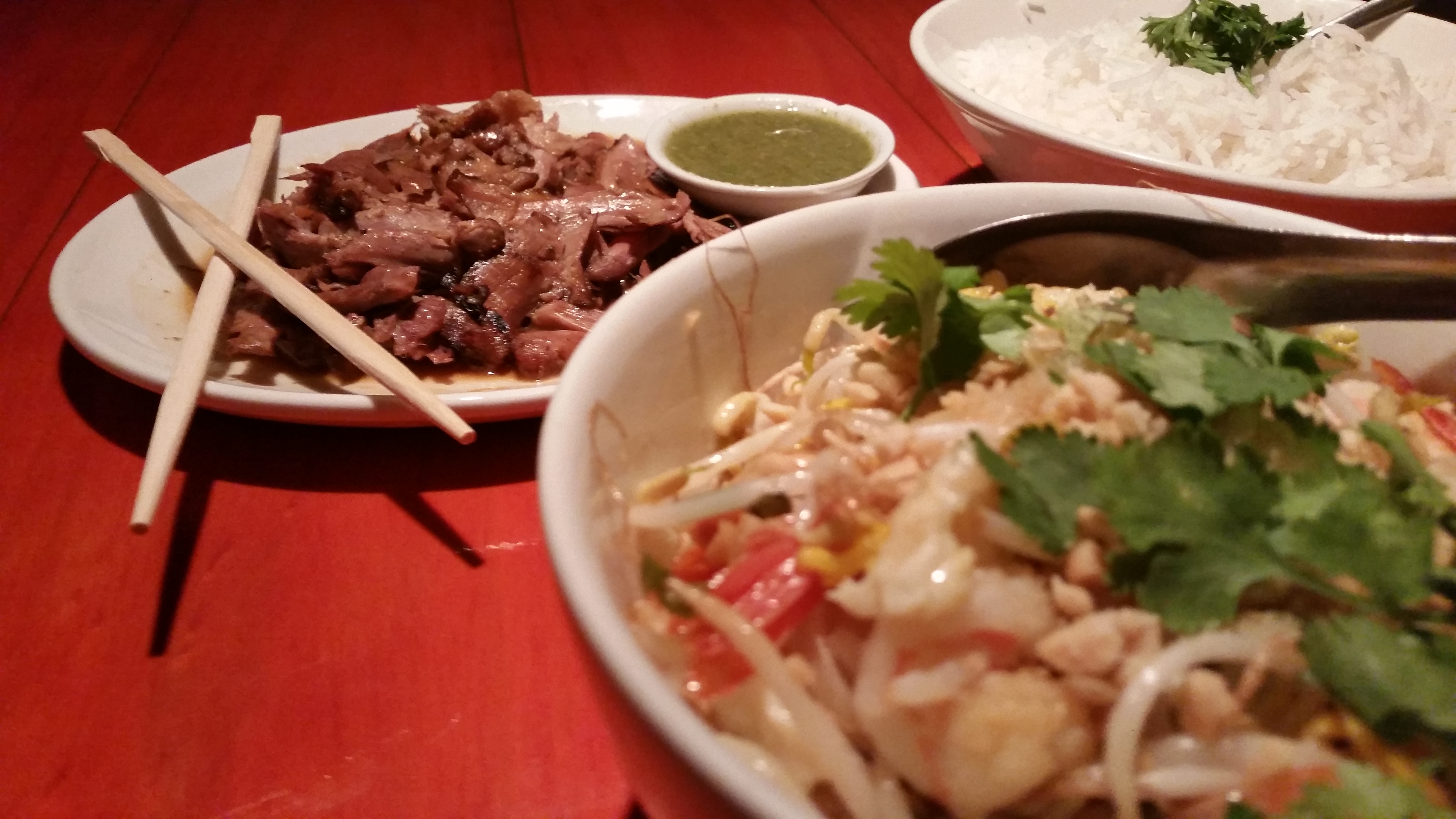 The prawn fried noodle dish is at the front and, in the back, the roast duck with green sauce
