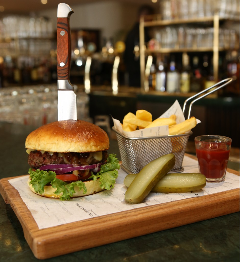 To eat this burger you need a big mouth - or that rather lethal looking knife