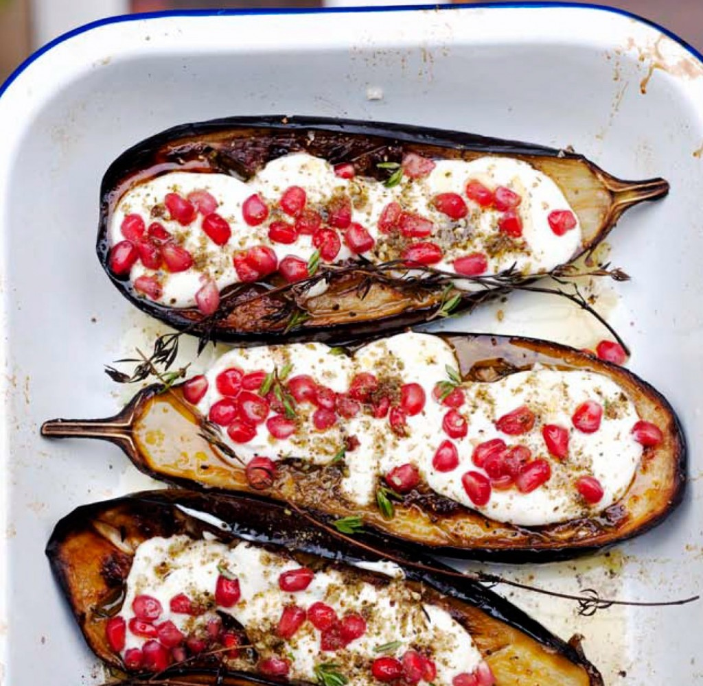Aubergine with buttermilk sauce and topped with pomegranate seeds