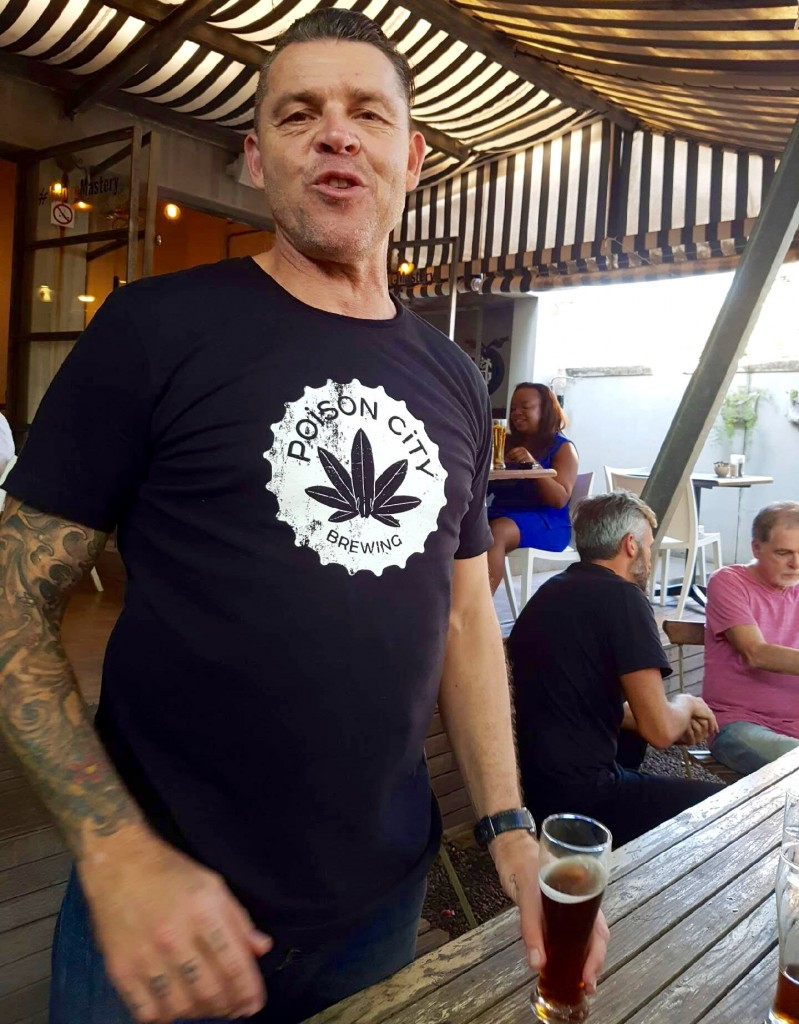 Poison City Brewing founder Andre Schubert doing what he does best ... talking. Behind him is fellow founder, Graeme Bird