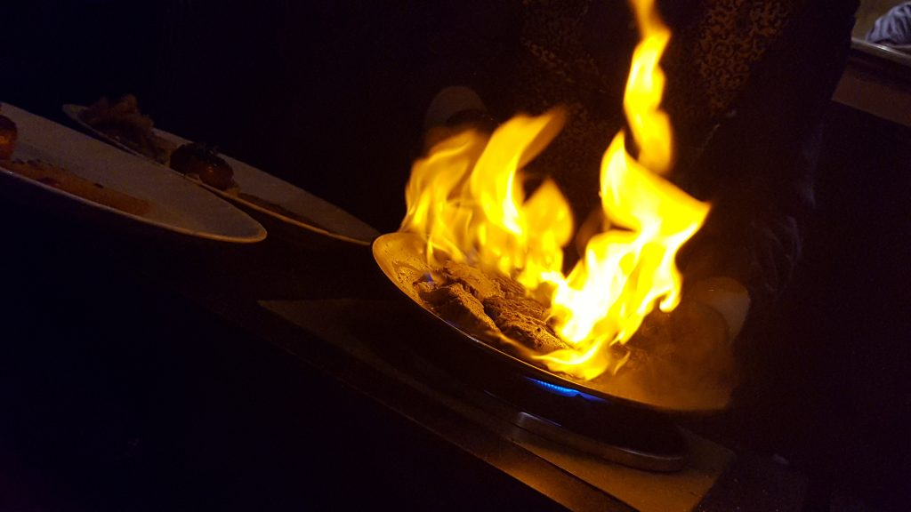 The dramatic moment our chateau briand is flamed in brandy
